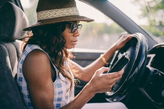 Woman Using Mobile Phone While Driving Car with low contrast filter