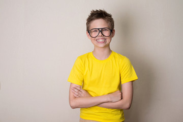 Health, education and people concept. Happy teen boy in braces and eyeglasses smiling.