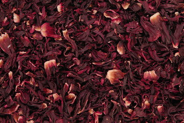 dry carcade  tea, creative texture background, red flowers of hibiscus