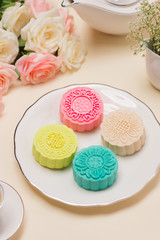 Pastel soft moon cake on white plate