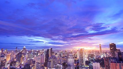 dramatic beautiful purple sky at sunset over cityscape
