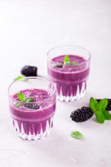 BlackBerry smoothie with Fresh Berries in glasses.Food or Healthy diet concept.Vegetarian.Copy space for Text. selective focus.
