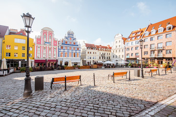 Obraz View on the Market square with beautiful colorful buildings during the morning light in Szczecin city, Poland - fototapety do salonu