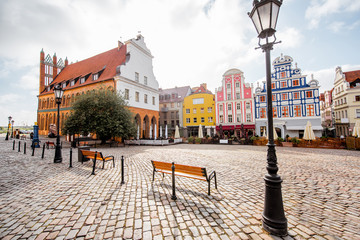 View on the Market square with beautiful colorful buildings during the morning light in Szczecin city, Poland
