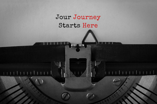 Text Jour Journey Starts Here typed on retro typewriter