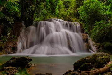 Photography of waterfall with long exposure. The beautiful waterfall in the national park in Kanchanaburi province, Thailand.