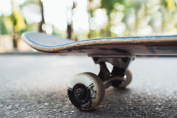 Skateboard on the road. Extreme sport challenge and skateboarder competition, close up picture of skate