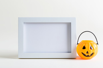 Empty photo frame with Halloween pumpkin decoration