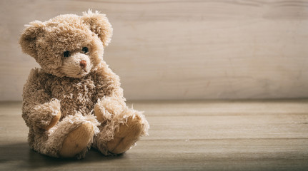 Teddy bear on a wooden floor