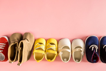 Baby shoes on a pale pink background
