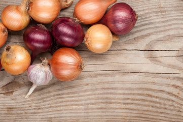 vegetables crop  on wooden background onions garlic, top view, copy space