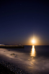 the moon in the starry sky by the sea and the moonlit path
