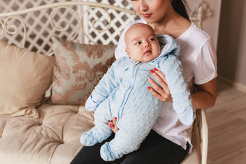 Loving Asian Mother Holding Baby Son At Home