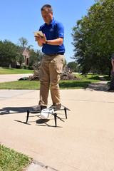 Farmers Insurance claims adjuster Brent Hazen preps a Kespry drone to assess a home damaged by Hurricane Harvey in Missouri City Texas