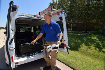 Farmers Insurance claims adjuster Brent Hazen unloads a Kespry drone he will use to assess a home damaged by Hurricane Harvey in Missouri City Texas