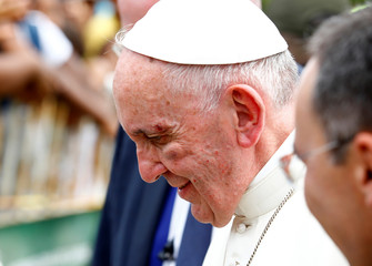 Pope Francis shows a bruise around his left eye and eyebrow caused by an accidental hit against the popemobile's window glass while visiting the old sector of Cartagena