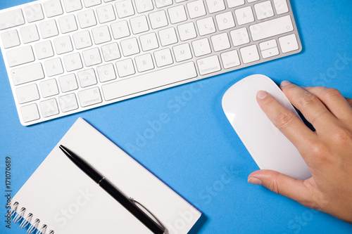 Computer keyboard, sketch-book and computer mouse from above on a