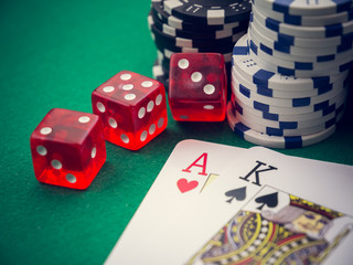 ace and king poker cards and cubes and casino chips