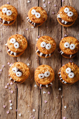 Halloween Dessert: funny monsters from cookies close-up. Vertical view from above