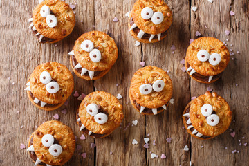 Peanut biscuit monsters for Halloween close-up on the table. horizontal view from above