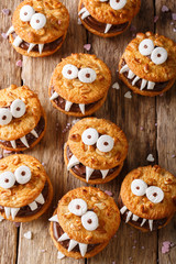 Peanut biscuit monsters for Halloween close-up on the table. vertical view from above