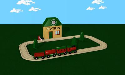 Holzeisenbahn für Kinder mit Bahnhof, Schienen und Schranke.