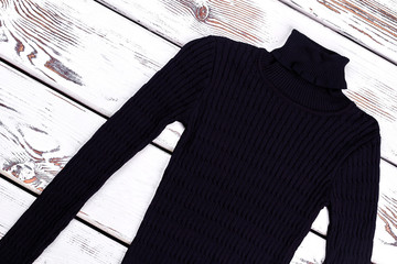 Turtleneck striped black sweater. Warm thick knitted winter sweater on vintage background. Winter knit wear.