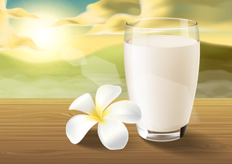 milk and plumeria on wooden table on the morning