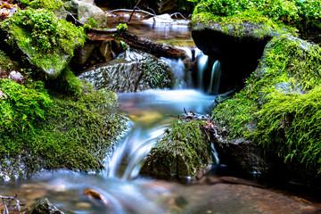 Fototapeta small waterfall on mountain stream obraz