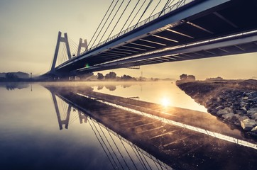 Photo sur Aluminium Pont Cable stayed bridge, Krakow, Poland, in the morning fog over Vistula river