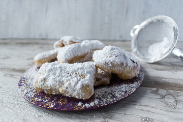 Homemade beignets with powdered sugar in rustic setting