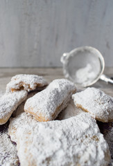 Homemade beignets with powdered sugar in rustic setting closeup