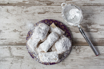 Homemade beignets with powdered sugar top view