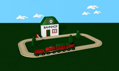 Wooden railway for children with station and rails.Text railway station in German.