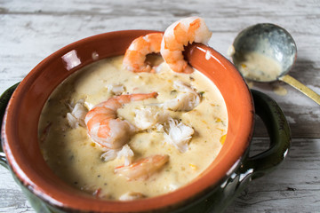 Seafood chowder in bowl closeup