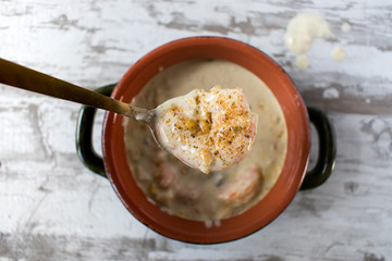 Spoonful of Seafood chowder closeup top view