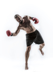 Professional boxer is fighthing,  isolated in white