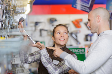 smiling confident male customer in a hardware store