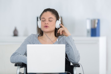 invalid girl on wheelchair listening music