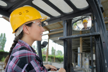 female worker in mirrow reflection