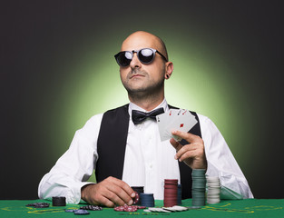 Poker player showing poker cards at the table