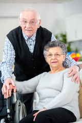 cheerful senior couple embracing each other