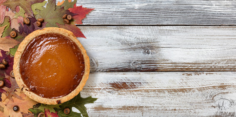 Baked homemade pumpkin pie for the Autumn holiday celebrations