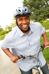 African American man riding a bike.