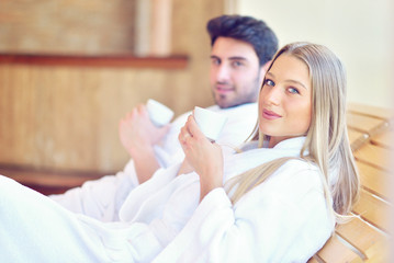 Beautiful couple relaxing together at spa centre after a beauty treatment