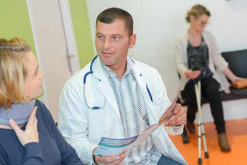 physiotherapist examining a patients neck in the clinic