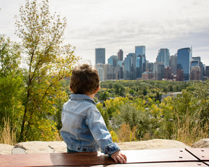 Little child admiring the view of Downtown Calgary