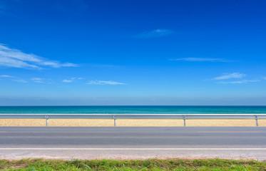 asphalt road and tropical beach