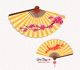 Classic Chinese new year blossom and oriental folding Paper Fan. Year of the dog. Chinese character hieroglyph: Dog