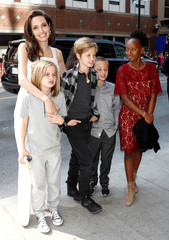 "Jolie arrives on the red carpet with her children for the film ""The Breadwinner"" during the Toronto International Film Festival in Toronto"